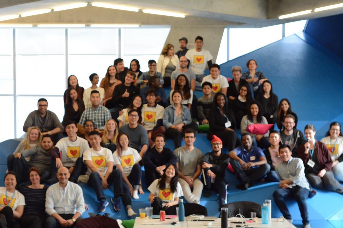 Social Good Hackathon Participants, Volunteers and Organizers pose at Sandbox's Foam Mountaint