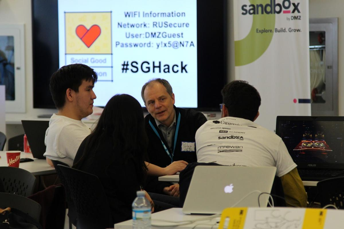 Mentor at the Social Good Hackathon speaking to participants