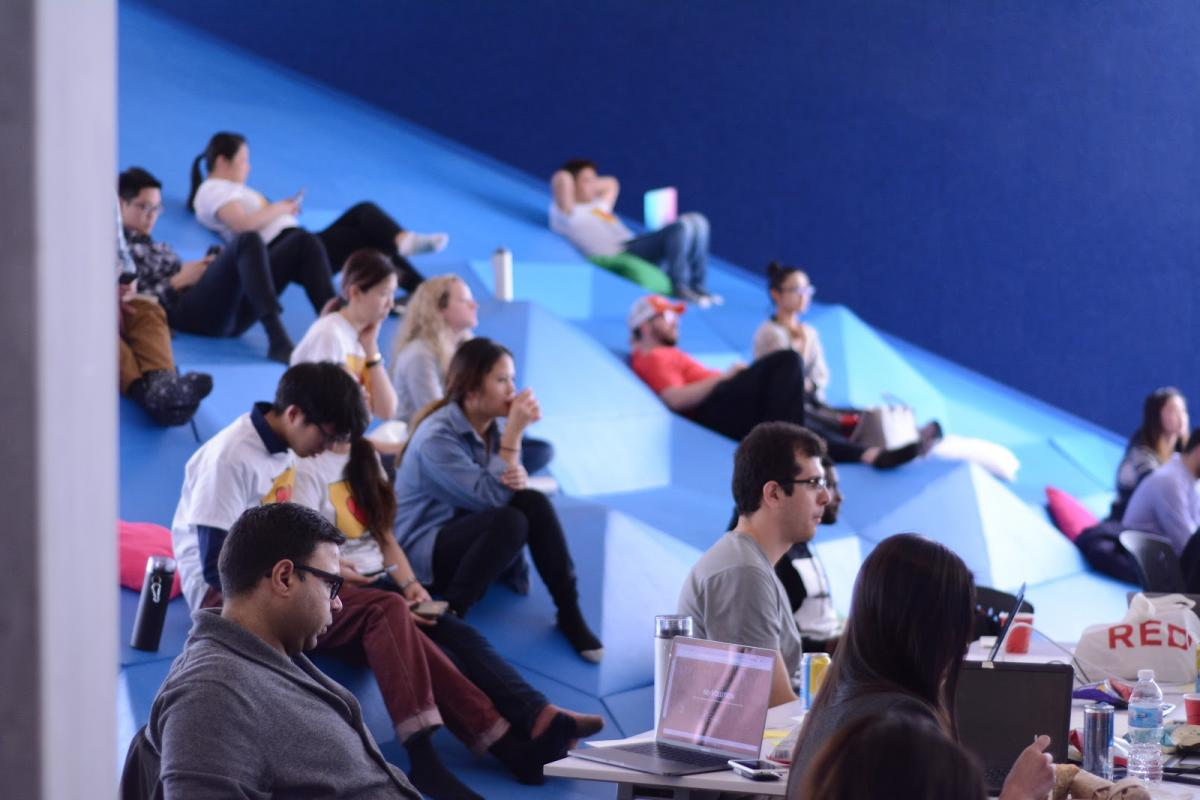 Participants listening to each other's presentations on the Sandbox's foam mountain