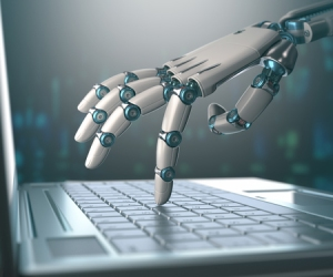 51001614 - robotic hand, accessing on laptop, the virtual world of information. concept of artificial intelligence and replacement of humans by machines. Copyright: ktsdesign / 123RF Stock Photo