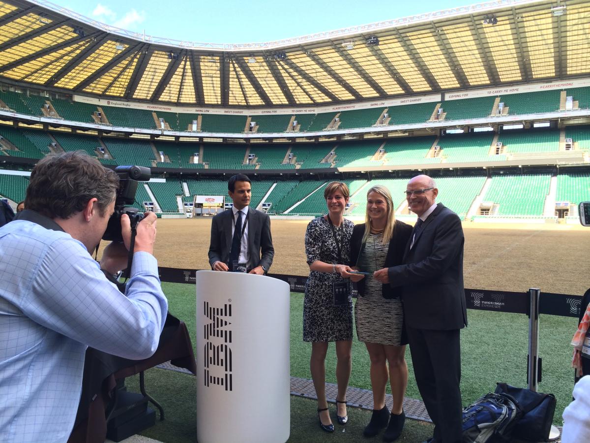 Louise Jeffrey, Capgemini IBM Alliance Director, and John Duncanson, VP, Capgemini receive award from Rachael Burford